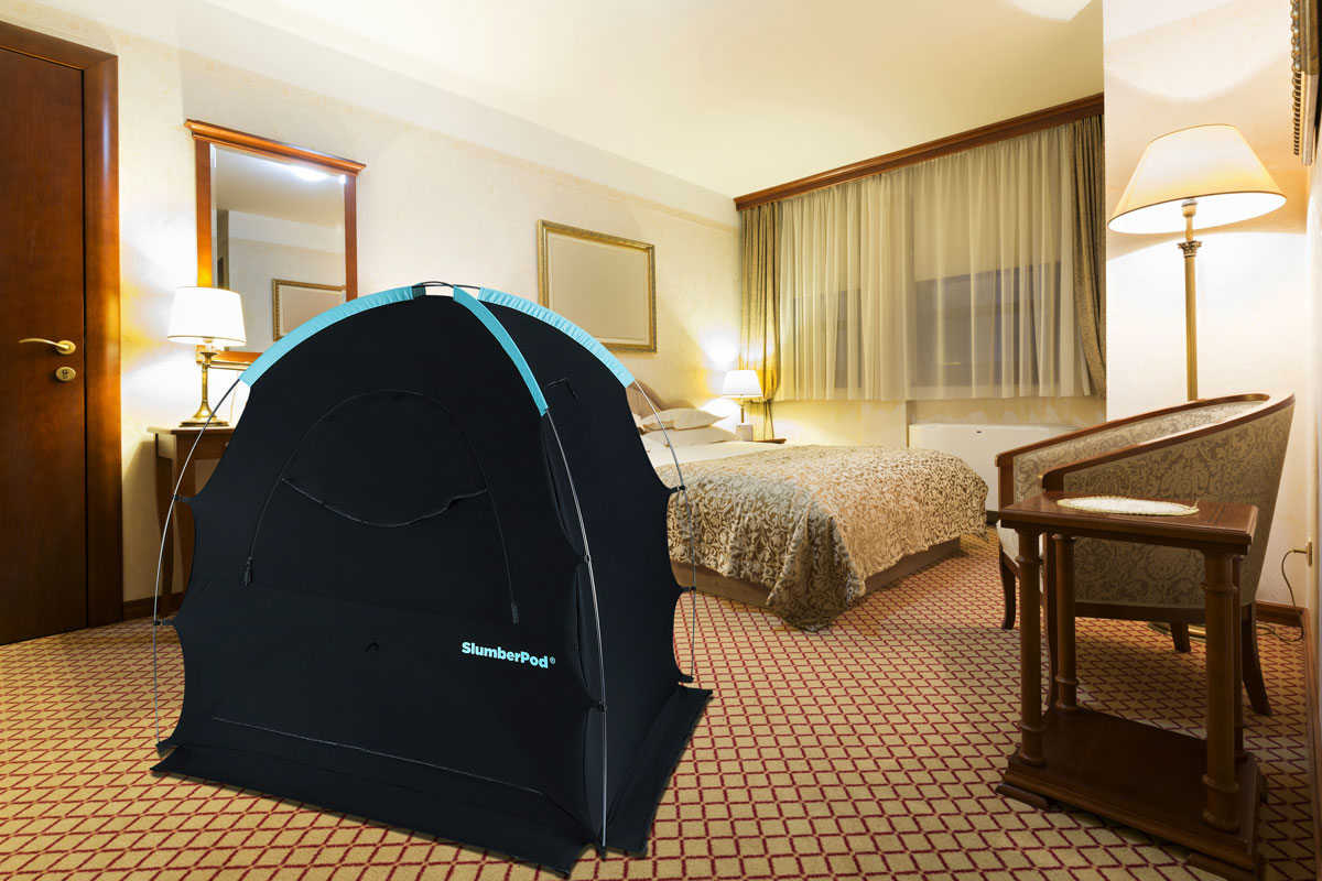image of slumberpod in hotel room - best baby essentials for travel