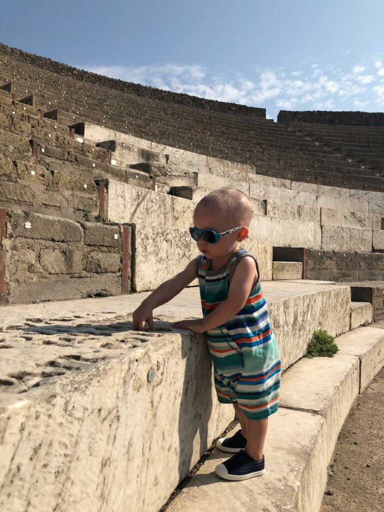 image of Pompeii with a toddler