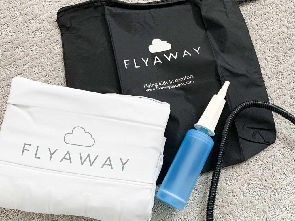 image of what's inside the box of the Flyaway Kids Bed - includes inflatable airplane cushion, travel bag and pump