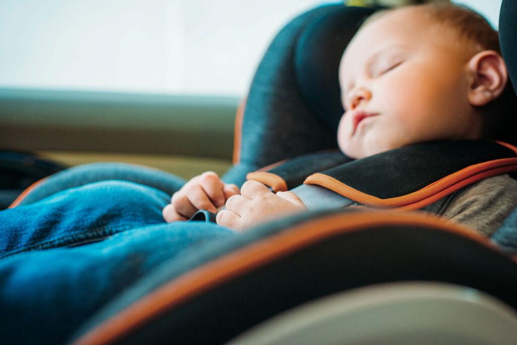 image of baby sleeping in car on road trip
