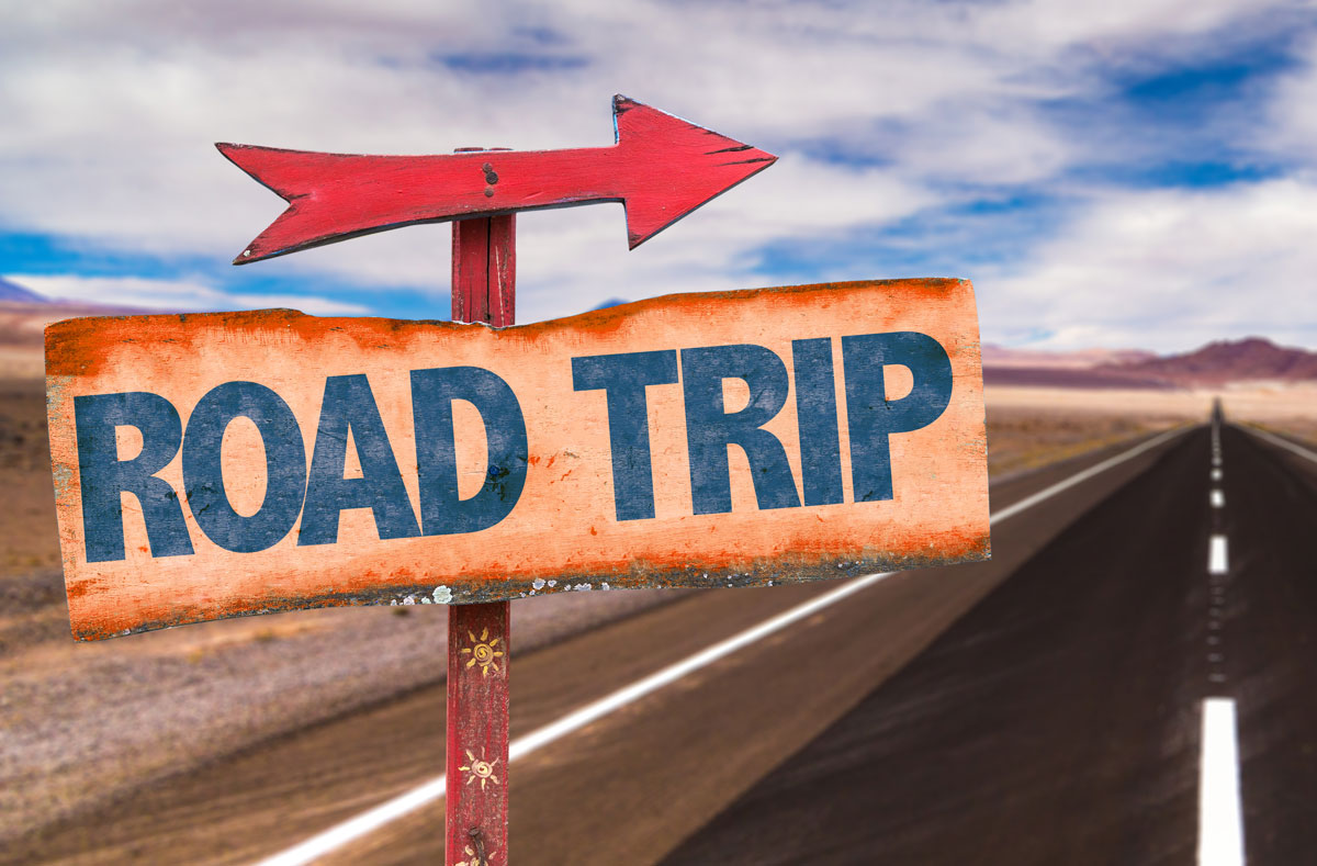 image of sign that says road trip
