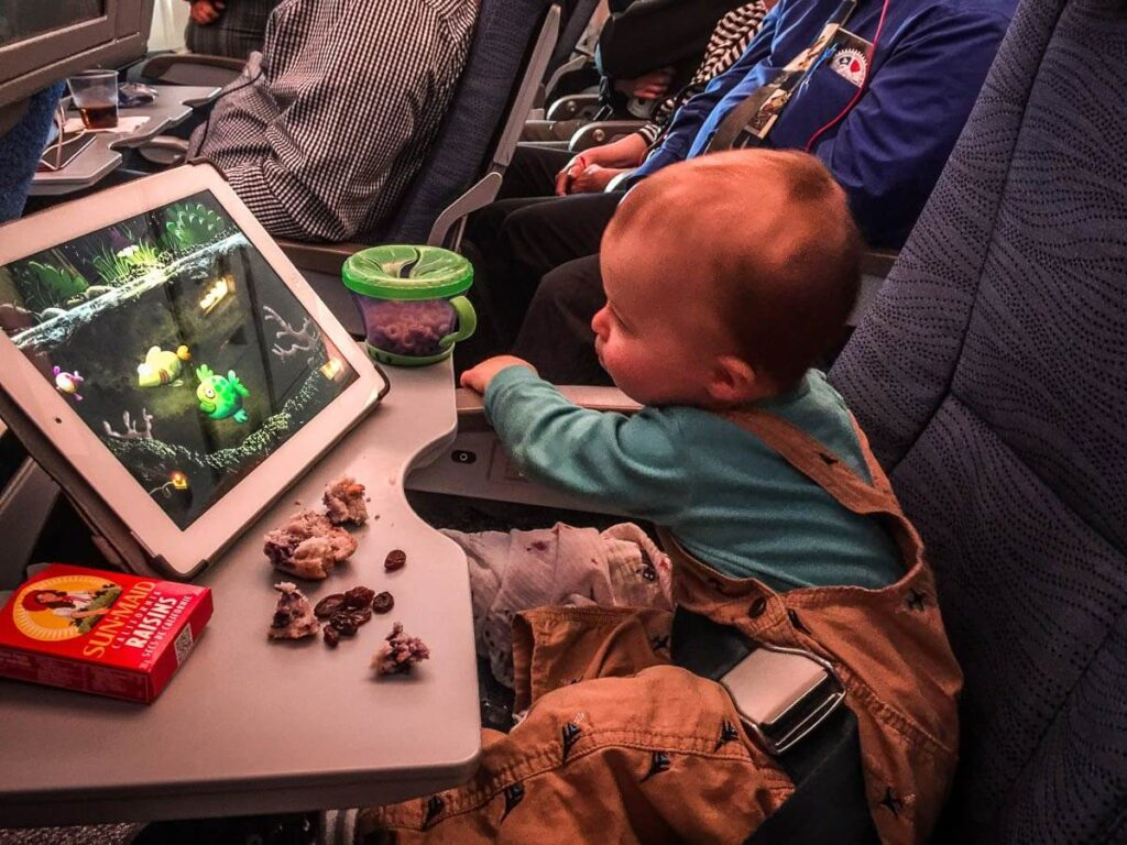 image of entertaining toddler on airplane