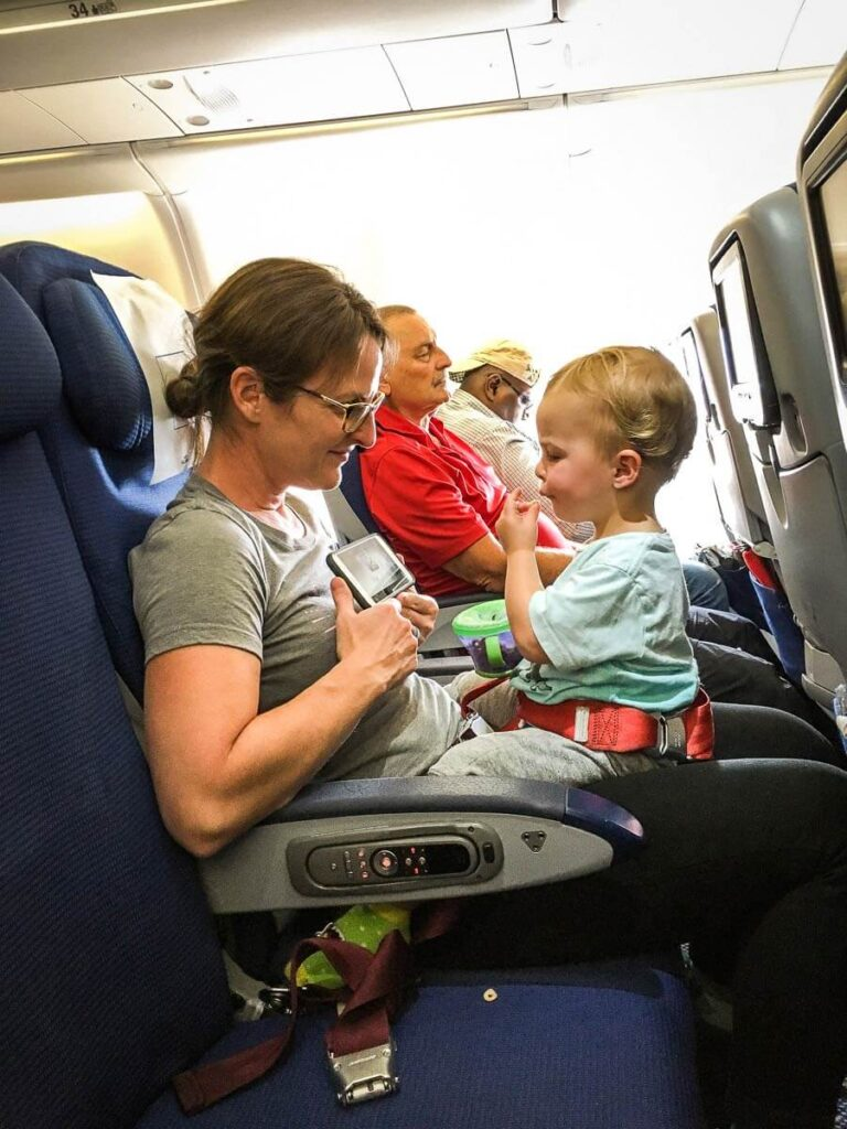 image of mother flying with a toddler on your lap