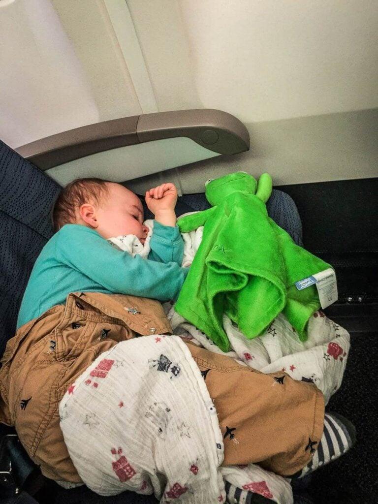 image of toddler sleeping on airplane