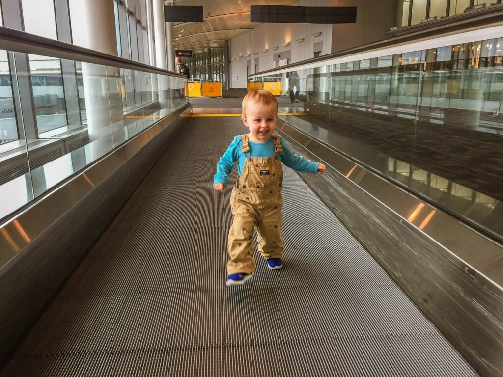 image of toddler running in airport