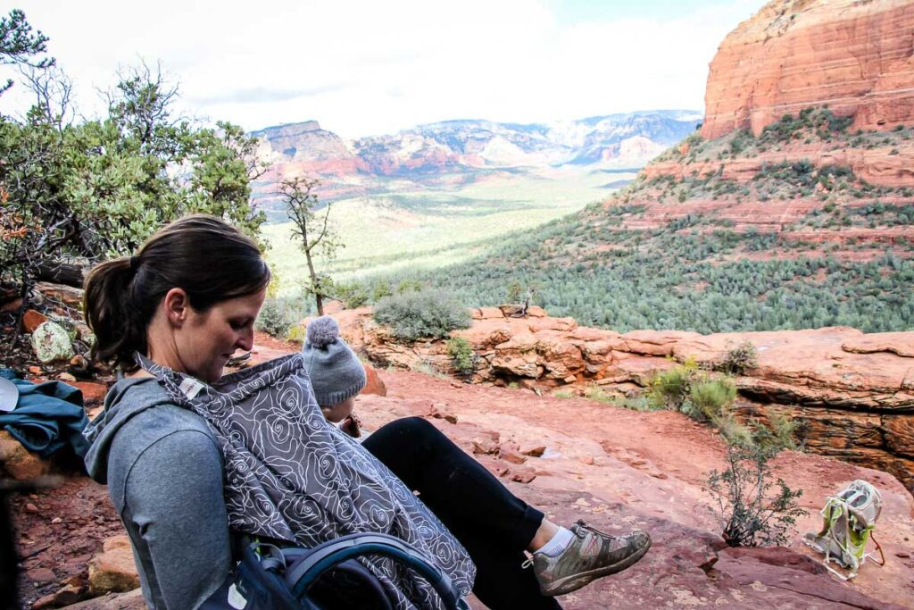 breastfeeding baby while hiking