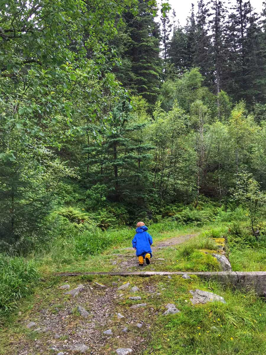 toddler in rain suit for hiking