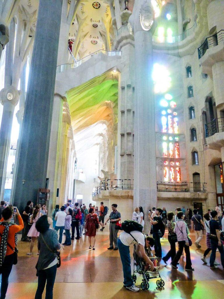 interior of Sagrada Familia and showing parents using stroller in Sagrada Familia