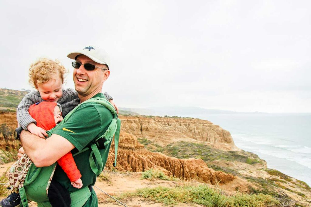 A family hug while on a kid-friendly hike in Torrey Pines Natural Reserve