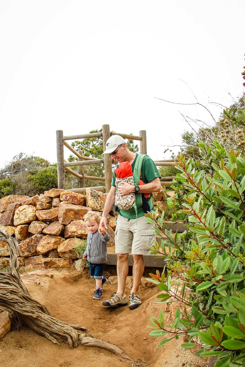 A father with his baby and toddler enjoy a fun walk at the Torry Pines Natural Rreserve just outside San Diego