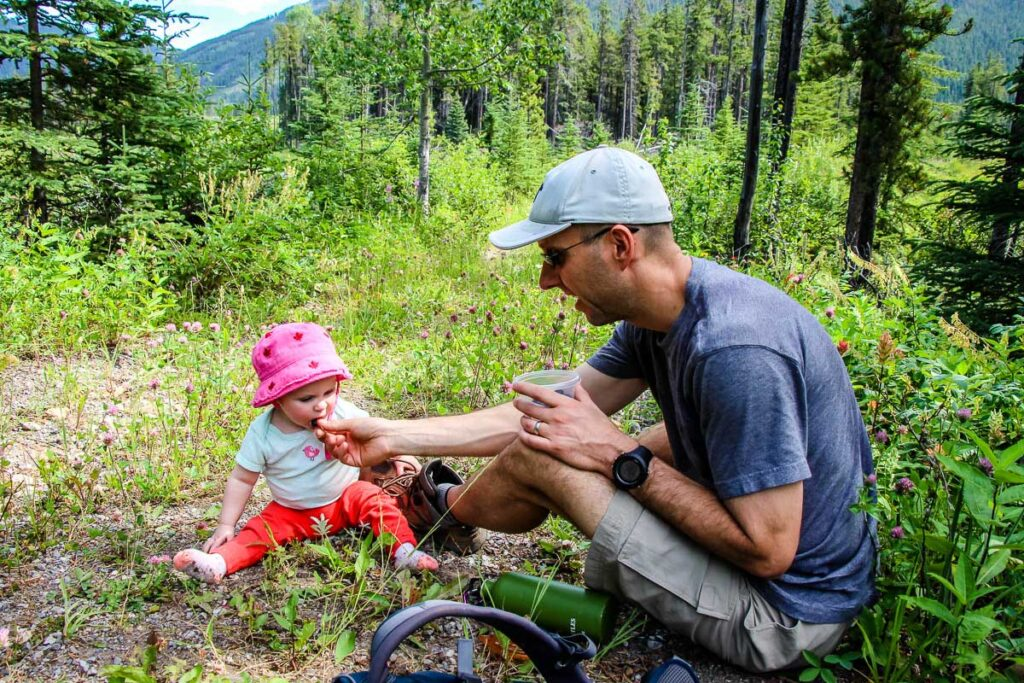 feeding baby while hiking