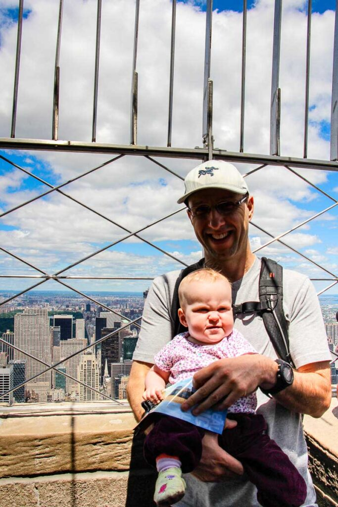 visiting empire state building observation deck in New York City with a baby