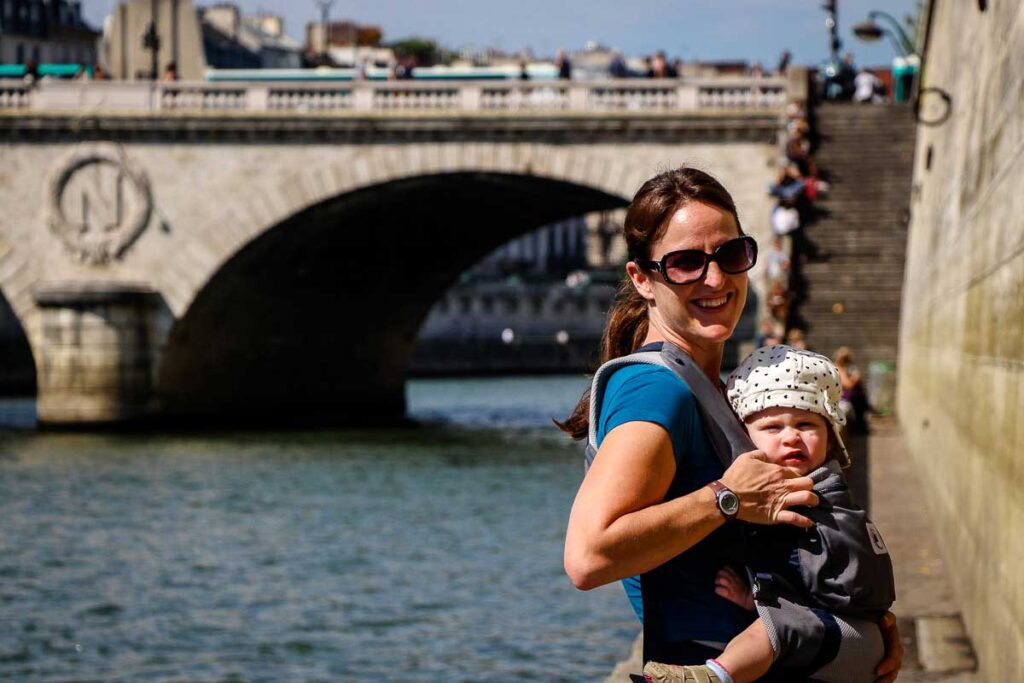 walking along la Seine in Paris with a Toddler in a carrier