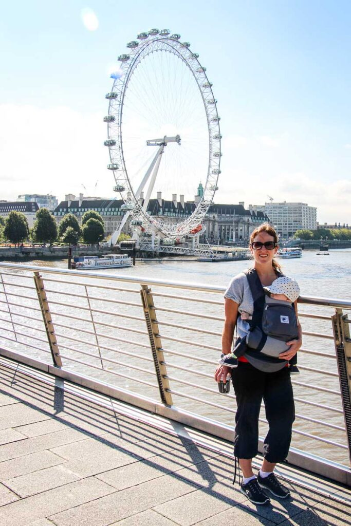standing in front of the London Eye with a baby in baby carrier
