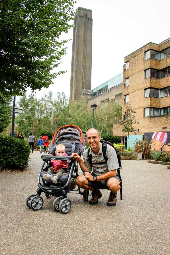 standing in front of Tate Modern in London with a toddler