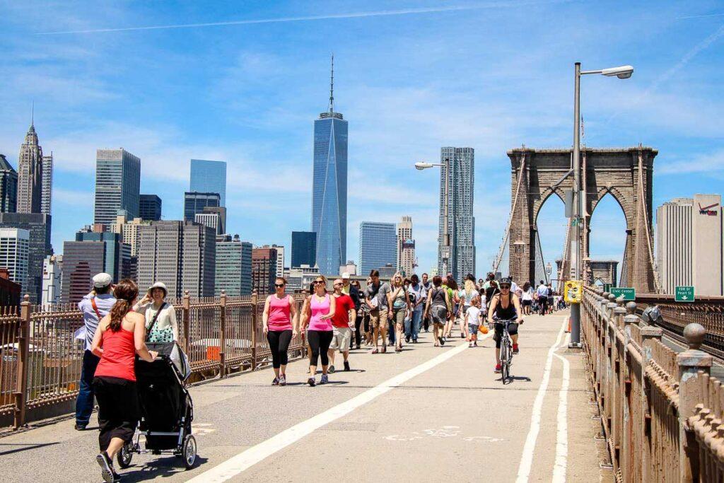 walking across brooklyn bridge with baby in stroller
