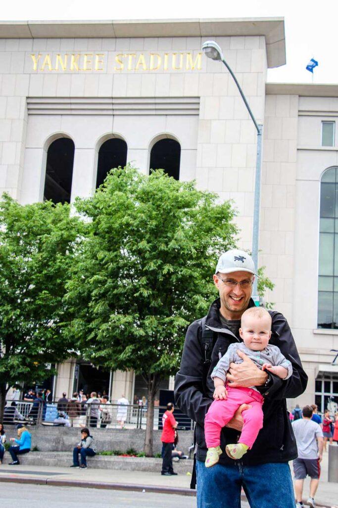 Holding baby outside of Yankee Stadium