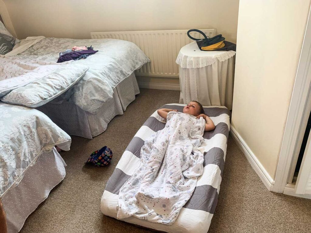 inflatable toddler travel bed. one of the best toddler travel essentials