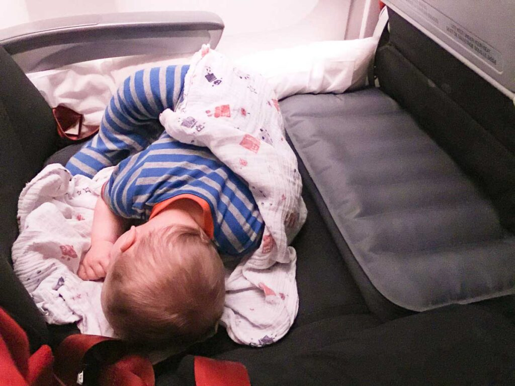 using inflatable airplane travel bed - best baby gear for travel