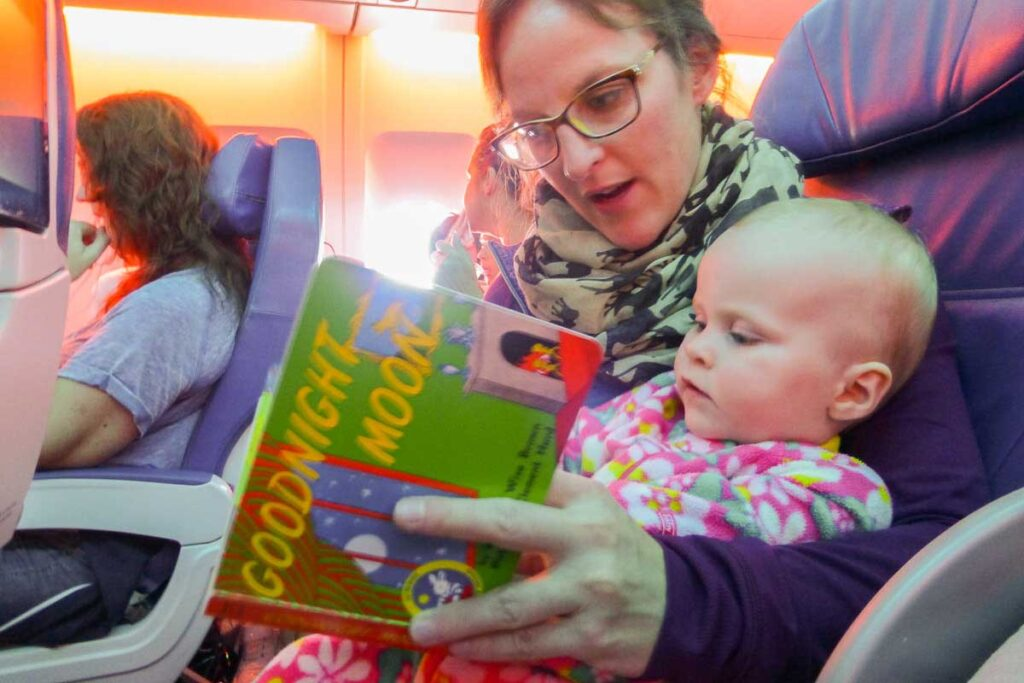 reading to get baby to sleep on airplane