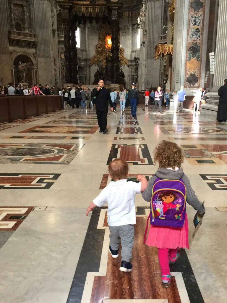 We hope our toddlers behave in front of the priest at St. Peters Basilica at the Vatican in Rmoe