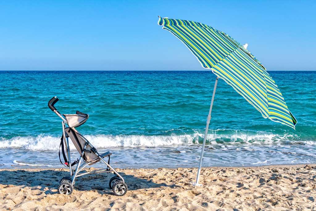 umbrella travel stroller on beach