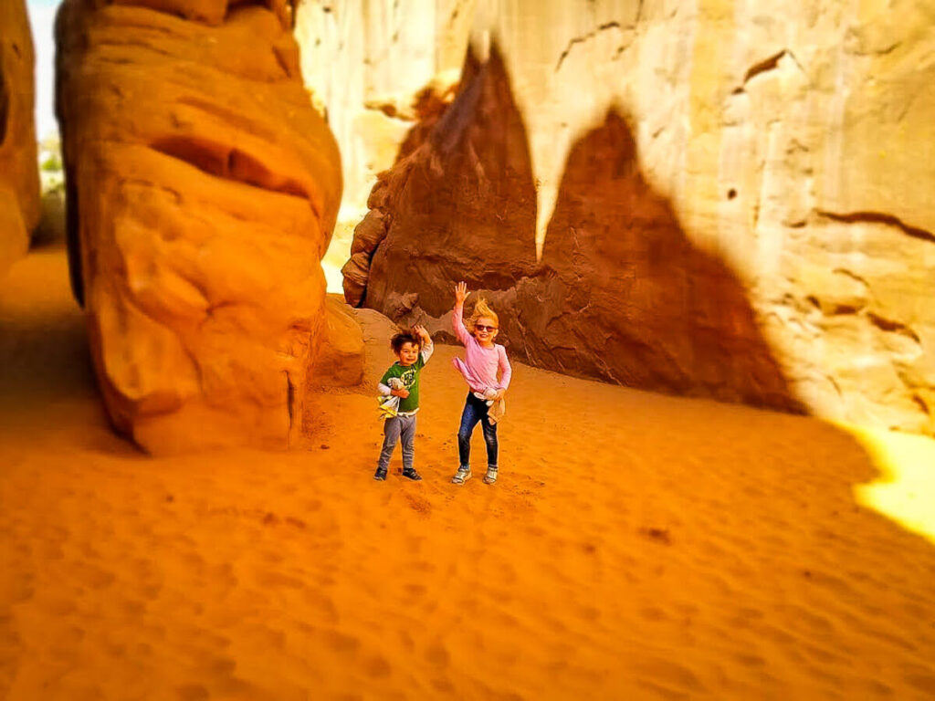 Sand dune Arch in Aches National Park with toddler