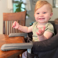 baby sitting in Inglesina Fast Table Chair - hook on high chair that attaches to table