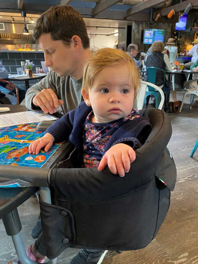 Baby sitting in Ingelsina high chair - attachable high chair to table