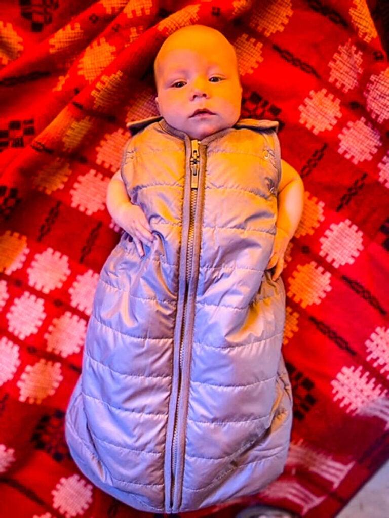 baby wearing Baby Deedee camping sleeping bag for baby - best baby camping gear
