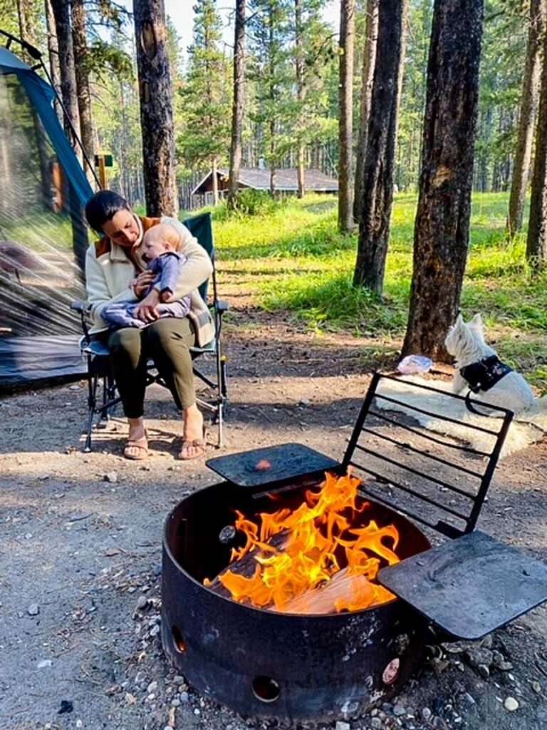 camping with a baby who is wearing one of the best baby sleeping bags for camping