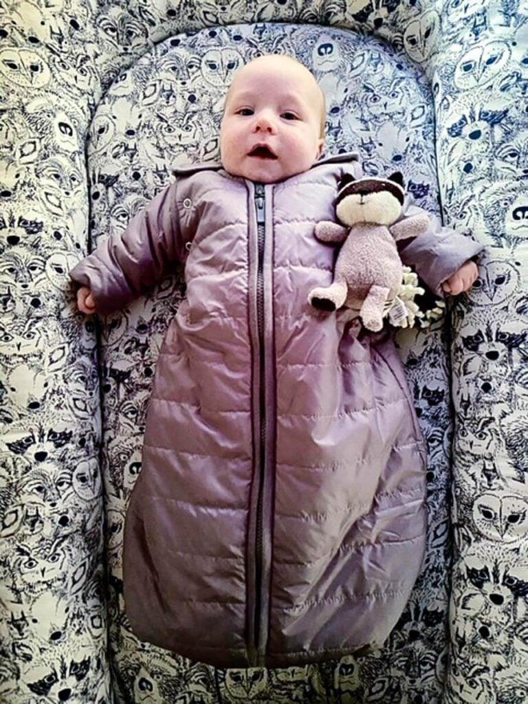 baby wearing Baby Deedee baby sleeping bag in camping bed for baby