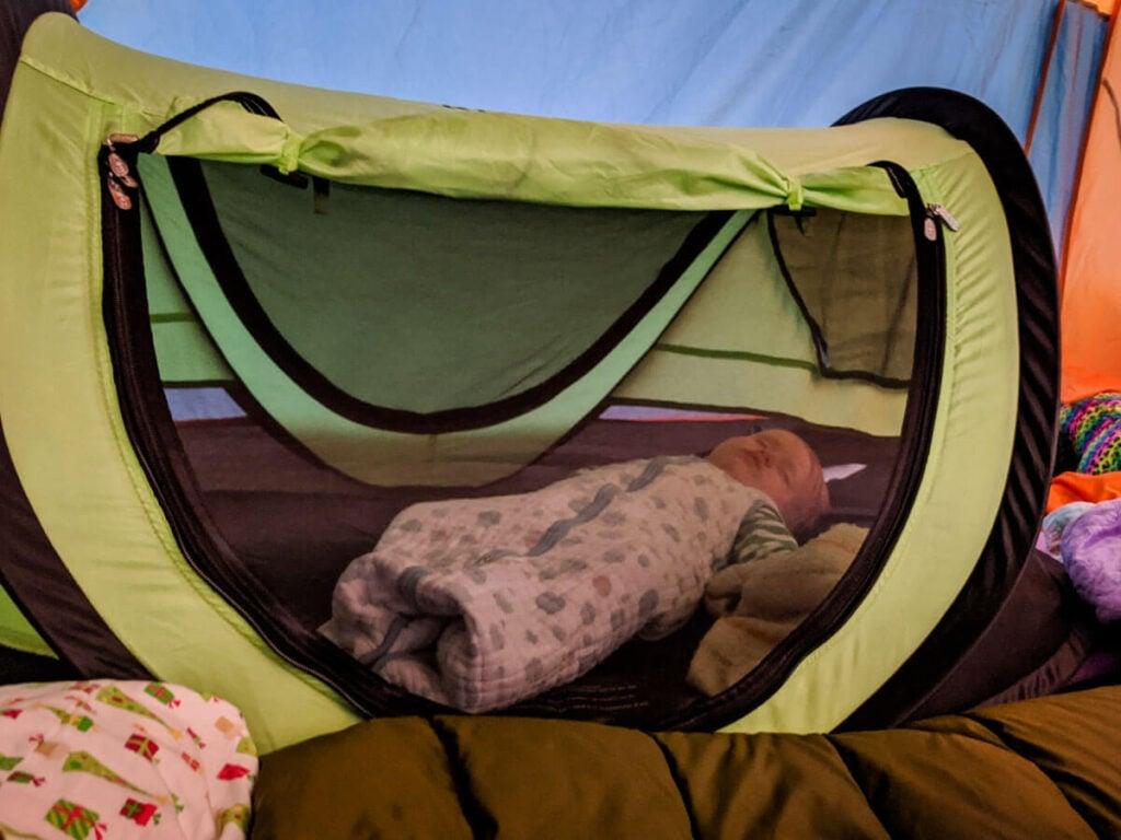 Toddler sleeping in Peapod Plus toddler camp bed