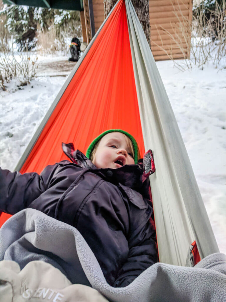 toddler in hammock - cold weather camping with a toddler