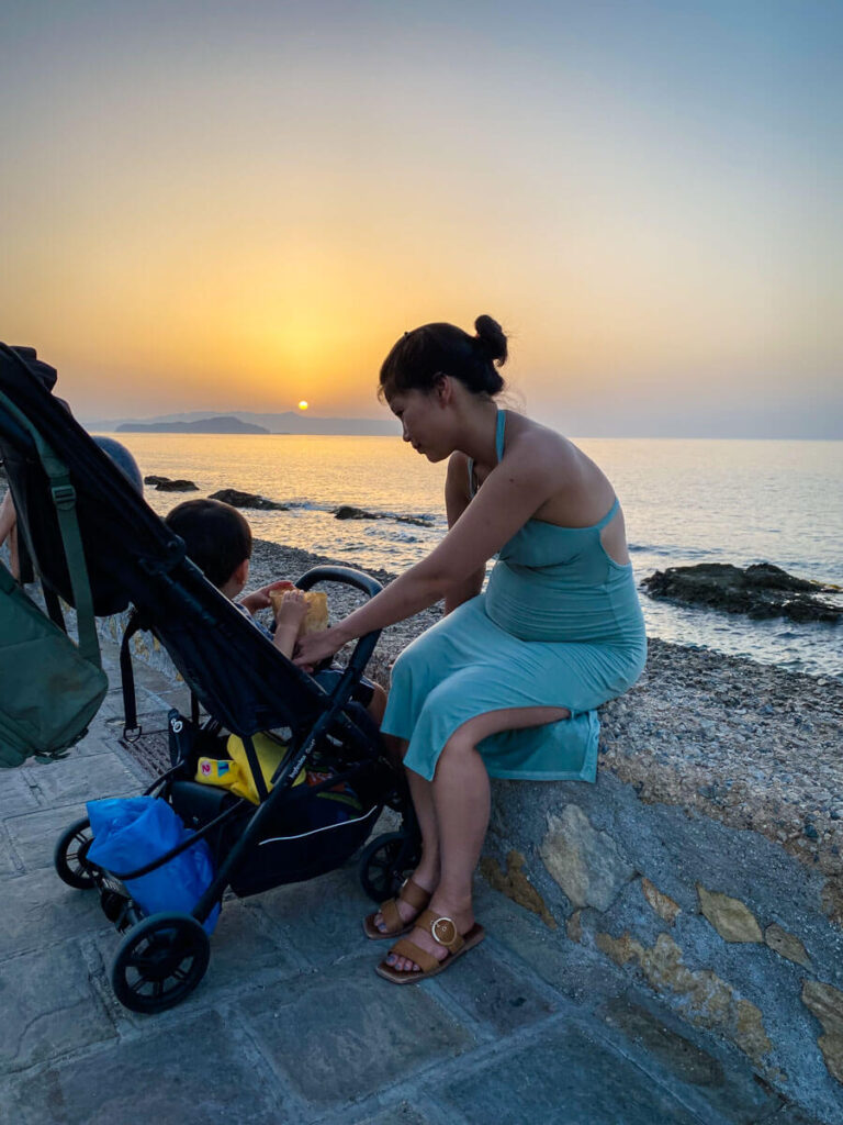 mother tending to toddler in a foldable compact stroller
