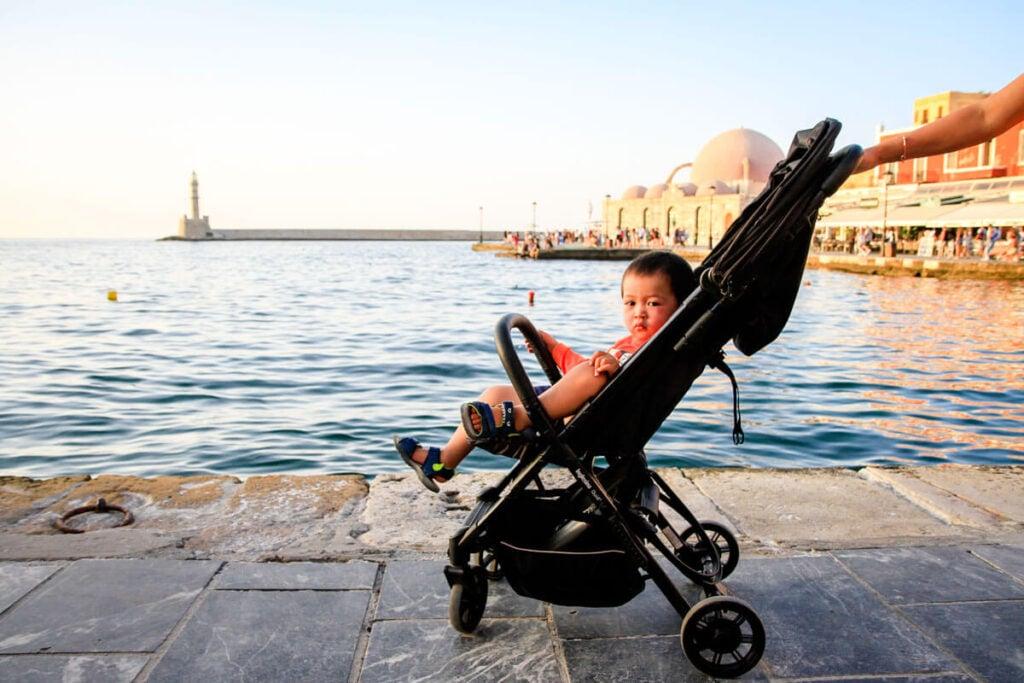 toddler in Crete sitting in light travel stroller