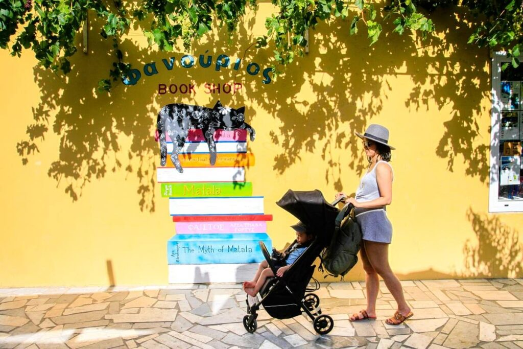 mother pushing lightweight compact stroller in Crete