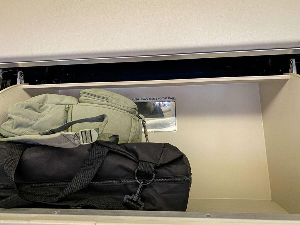 compact folding stroller Inglesina Quid fits in overhead bin on airplane