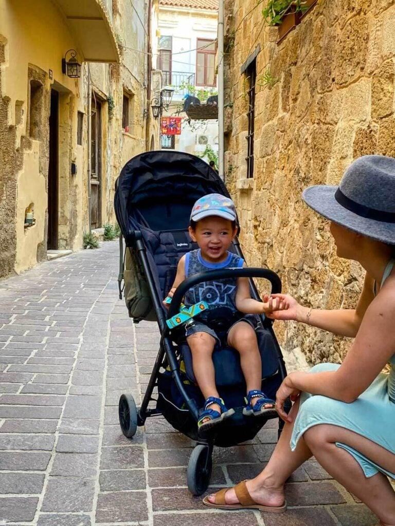 toddler sitting in Inglesina Quid travel stroller