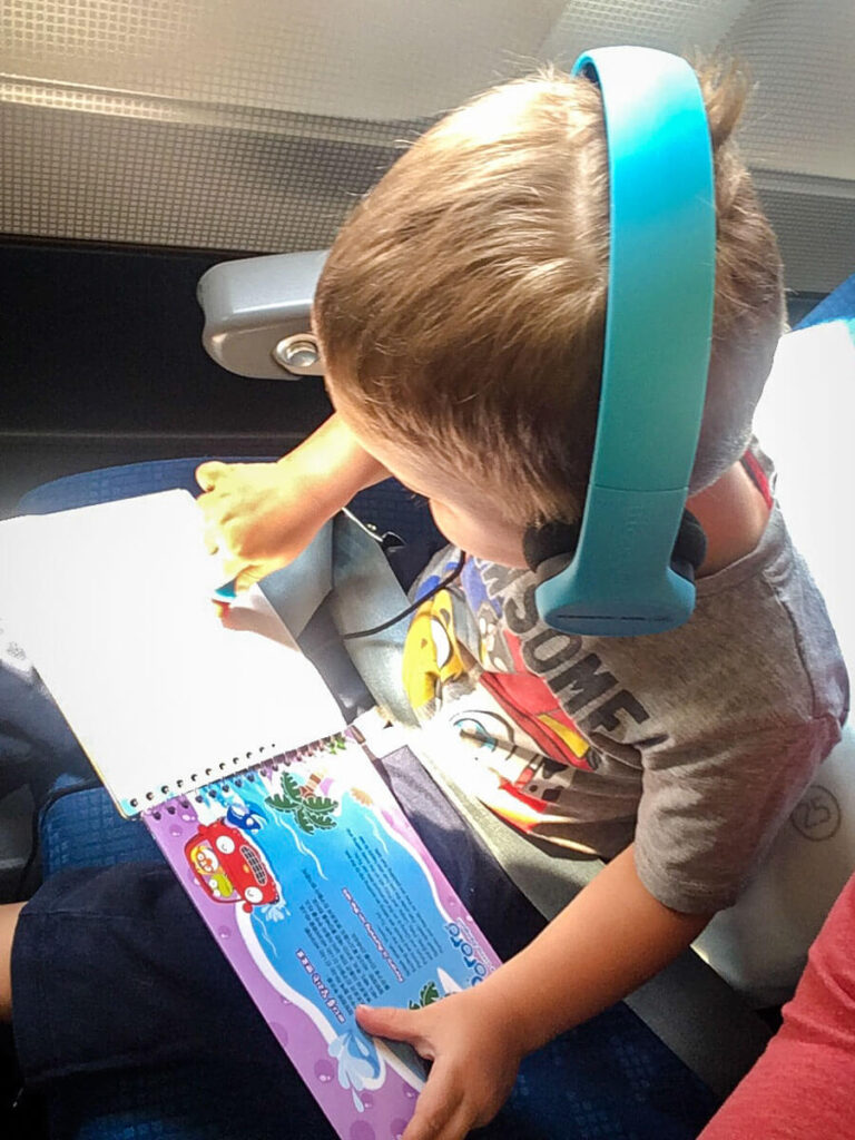 flying with toddler wearing best headphones for a toddler