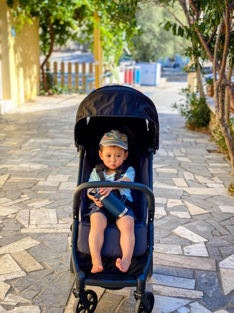 Toddler sitting in Inglesina Quid - compact folding stroller
