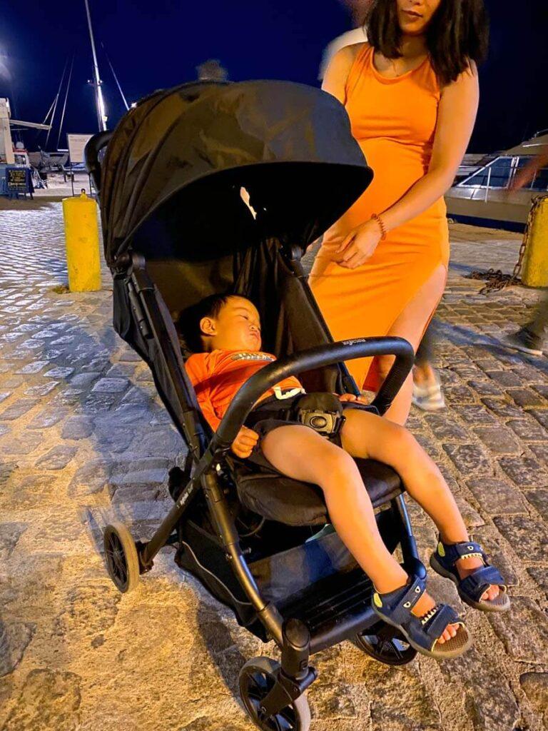 toddler asleep in Inglesina stroller